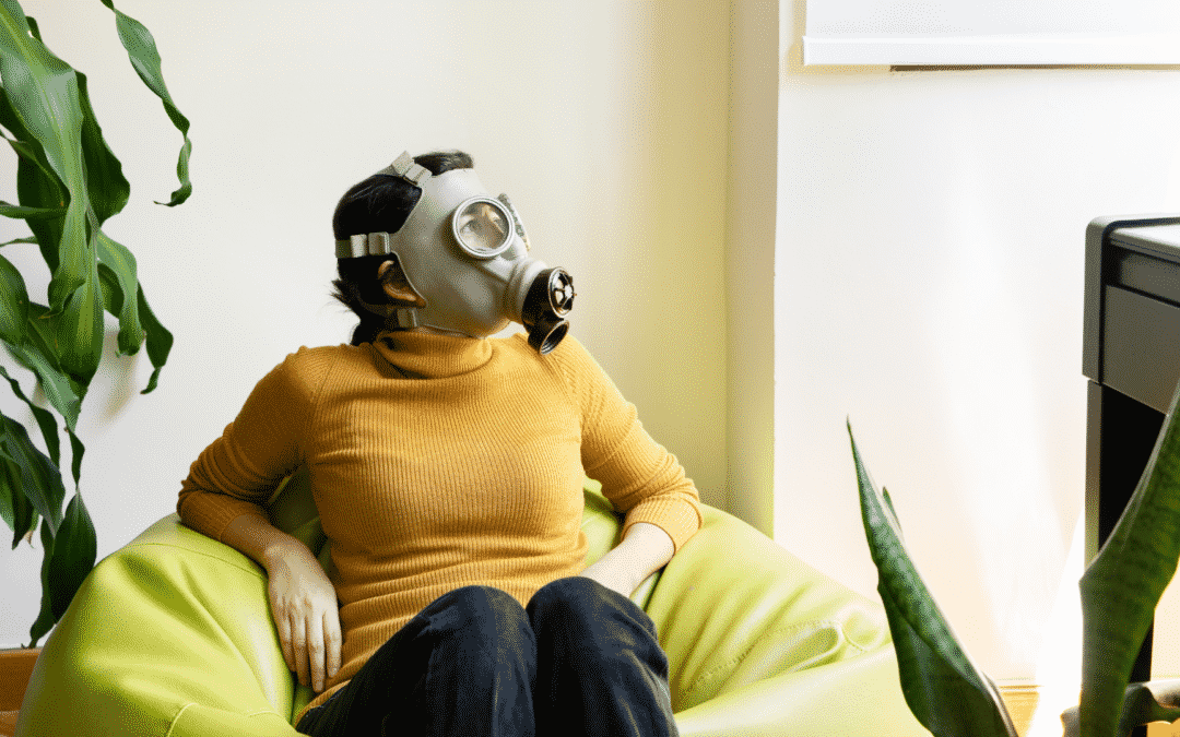 women with gas mask sitting in bean bag chair
