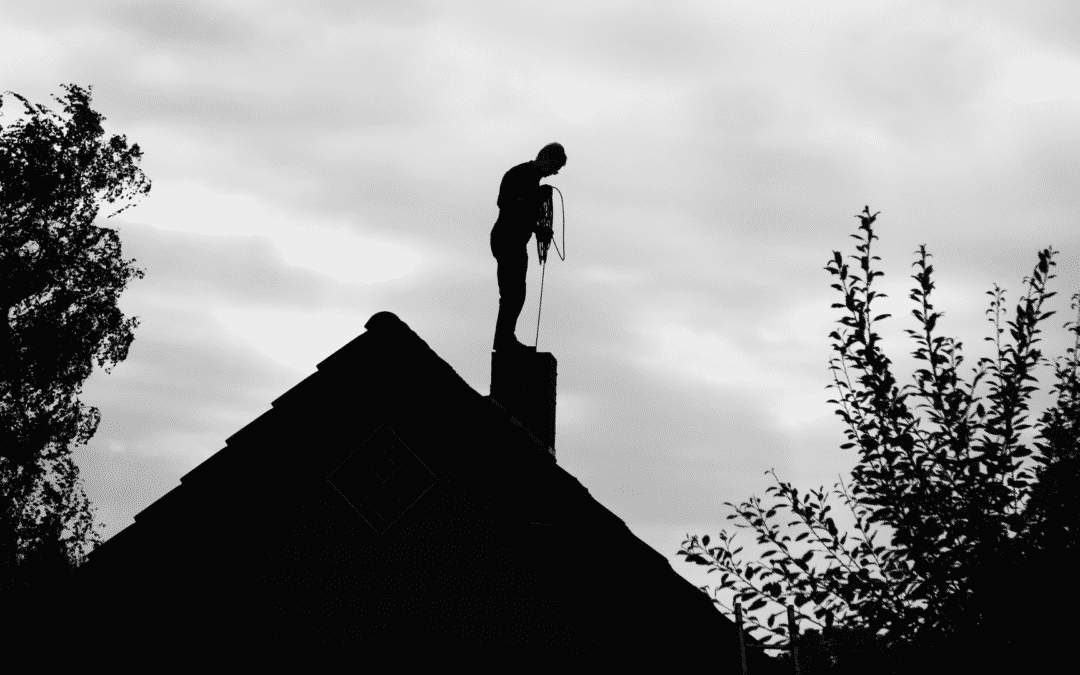 chimney sweep on roof silhouette