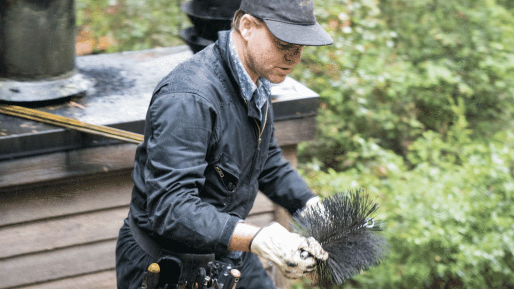 chimney sweep attaching brush to extension